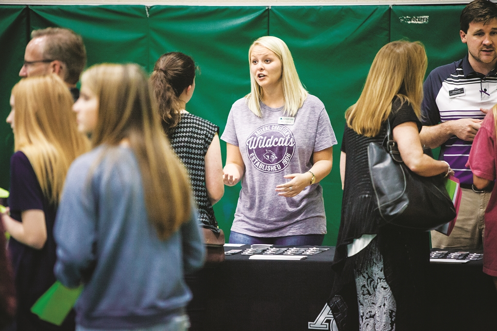 Thannum volunteered to work at a college fair in the school district where she teaches in South Lake, Texas.